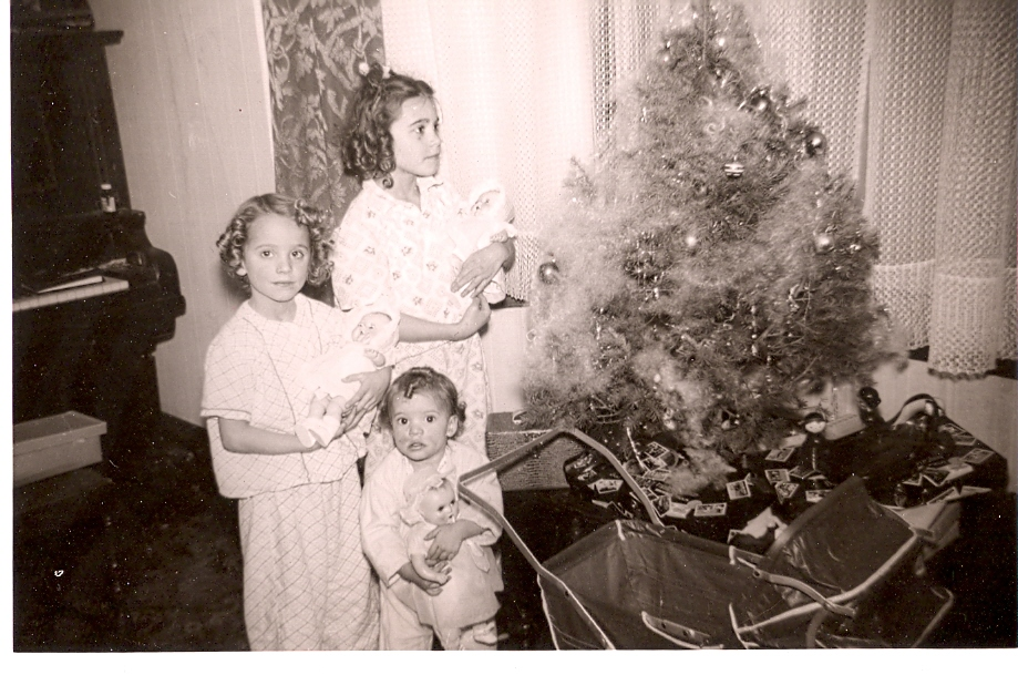 My sisters and I one Christmas, a very long time ago. I am the youngest and smallest one.