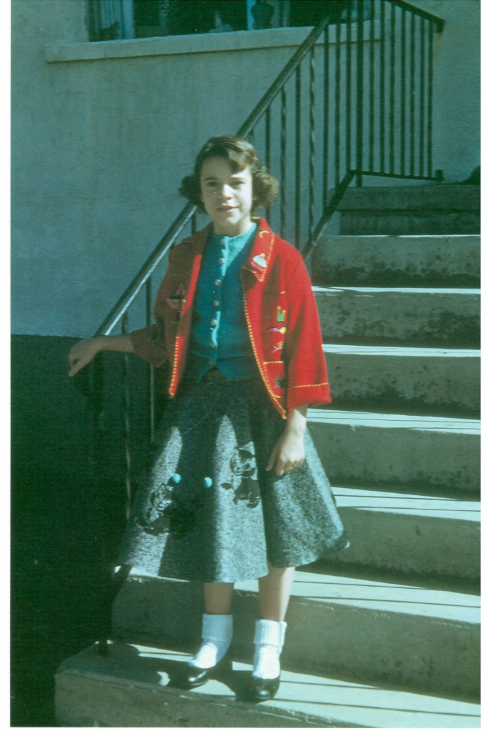 That's me at age 10 I think in my 'poodle skirt'. Wish I still had it. :)